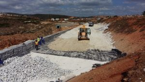 Construction of retaining wall fill reinforcement using geogrids and G7 material | JG Afrika